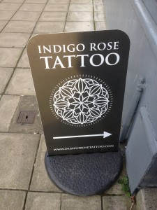 Indigo Rose Tattoo Pavement Sign (Ecoflex)